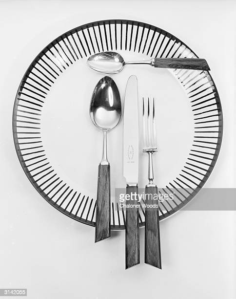 A knife fork spoons and op art dinner plate set for one
