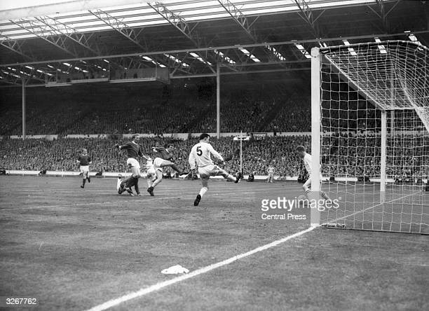 David Herd of Manchester United scores his second and his team's third goal during the FA Cup Final against Leicester City at Wembley Stadium United...