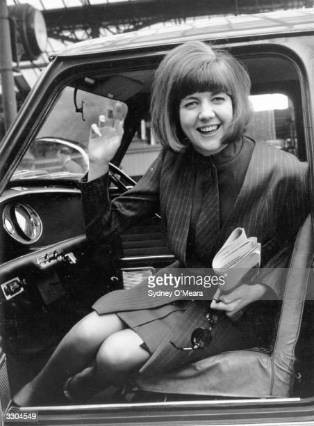 Pop singer Cilla Black in her mini.