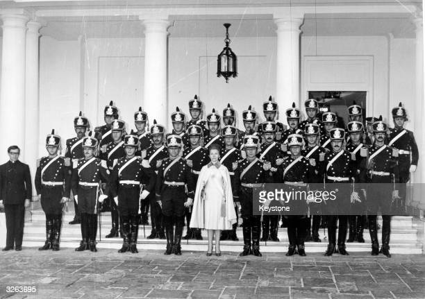 Maria Estella Martinez Peron with the traditional presidential bodyguards on the steps of the presidential residence at Olivos in the outskirts of...