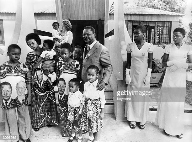 Jean Bedel Bokassa Emperor Bokassa of the Central African Republic with his family A photograph taken to show that he was a loving family man after...