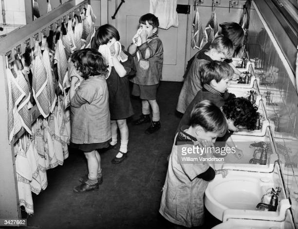 Children in the washroom at the LCC Columbia Nursery School in Bethnal Green London