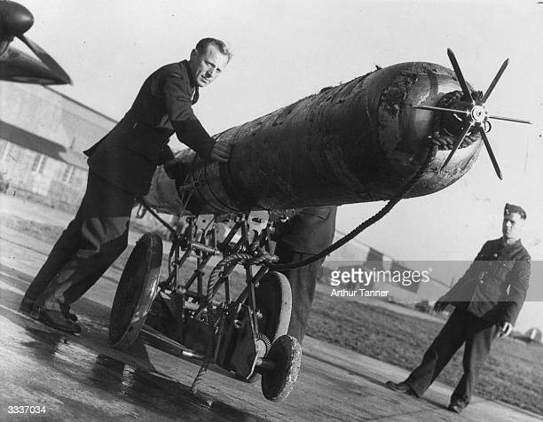 A torpedo is wheeled out ready for loading onto a 'Bristol Beaufort' The Fleet Air Arm has found this weapon to be highly effective ainst enemy...