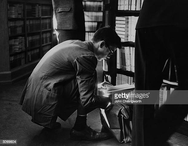 An undergraduate browsing through one of Oxford's many bookshops Original Publication Picture Post 5159 Eternal Oxford pub 1950