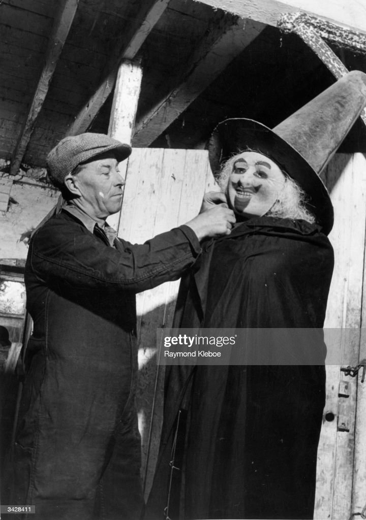 A man dresses up a dummy Guy Fawkes in preparation for Bonfire Night in the East Susses town of Lewes. Original Publication: Picture Post - 5463 - Fireworks - unpub.