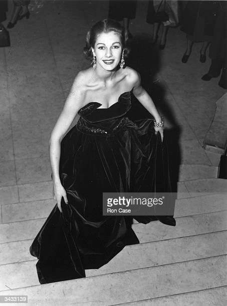 20yearold fashion model Fiona Walters wearing a twopiece bodice and skirt evening gown in heavy bottle green velvet trimmed with emerald green and...