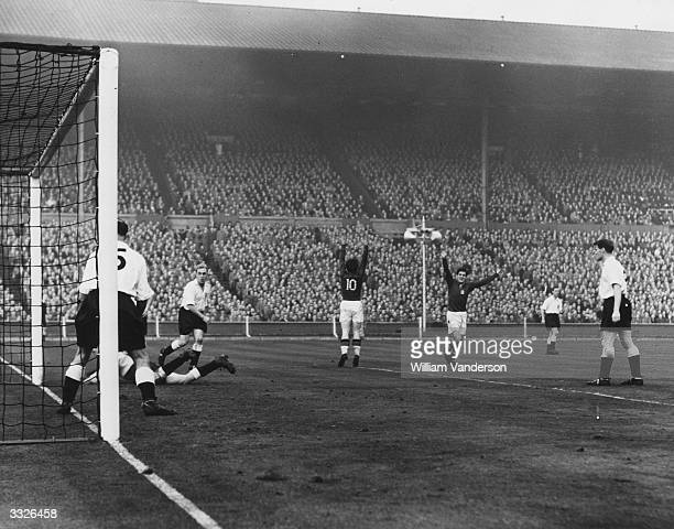 Hungary's third goal is scored by the team captain Ferenc Puskas during their match against England at Wembley Stadium