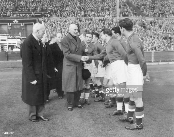 The Earl of Athlone shaking hands with the Hungarian football team before their match against England at Wembley stadium