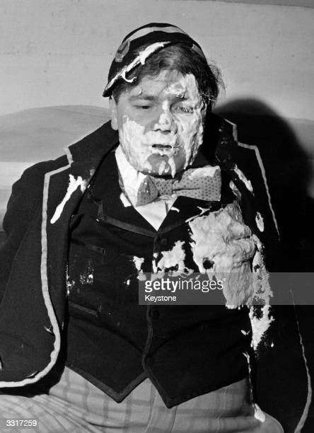 Actor Keith Banks as 'Billy Bunter' covered in custard pie after meeting members of the 'Crazy Gang' at Victoria Palace Theatre London