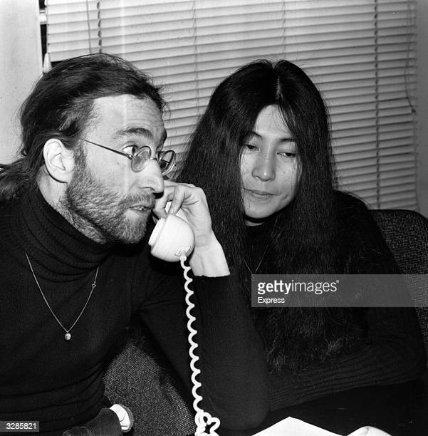 John Lennon singer and songwriter with his wife artist Yoko Ono during the press conference held after he returned his MBE to the Queen in protest...