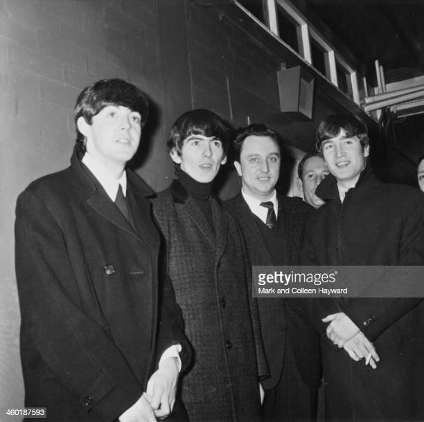 The Beatles pose with English comedian Ken Dodd backstage at Granada TV studios in Manchester England on 25th November 1963 Left to right Paul...
