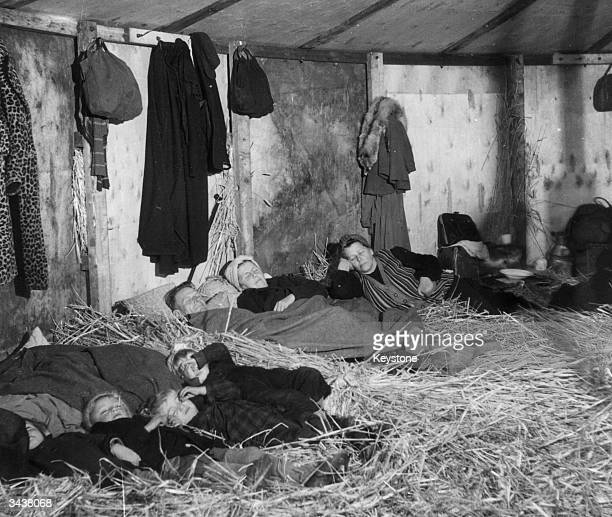 German refugees fleeing from the Russian zone in the first few weeks after the end of World War II in Europe They are sleeping on straw in a...