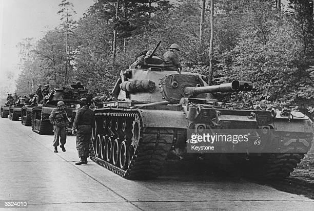 American tanks on alert in the Berlin Grunewald, West Germany, as the crisis over the Cuban blockade looms during the Cuban missile crisis.