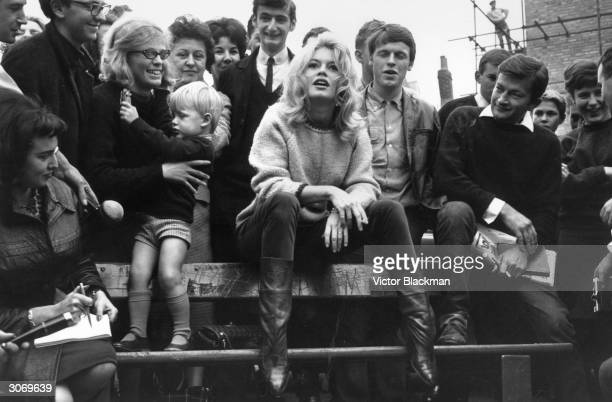 Brigitte Bardot in Hampstead London for the filming of 'The Adorable Idiot' talks to the press and her fans