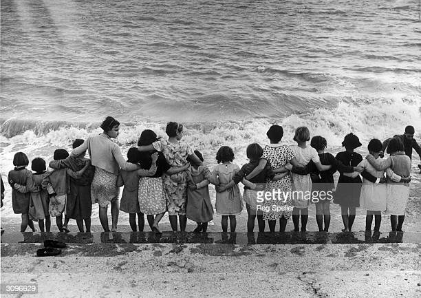 A group of Basque children refugees from the Spanish Civil War standing on the sea front at St Mary's Bay Holiday Camp New Romney Kent They are being...