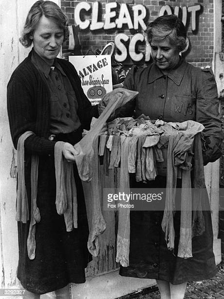Old silk stockings collected by the WVS are used by airmen under their own socks as a additional means of keeping warm and are also used to keep...