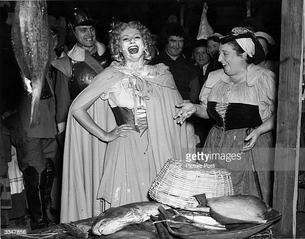 British actress Margaret Lockwood laughs after getting a custard pie in the face from Joan Young during the making of her first slapstick film 'The...