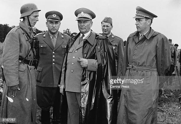Marshal Tito discussing army manoeuvres with Yugoslav Secretary of Defence Ivan Gosnajak General Zezelj and commander of manoeuvres General Kosta Nadj