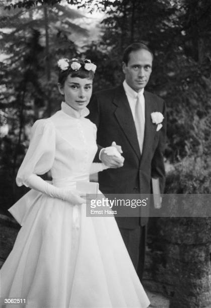 Film star couple Audrey Hepburn and Mel Ferrer on their wedding day Dress designed by Balmain