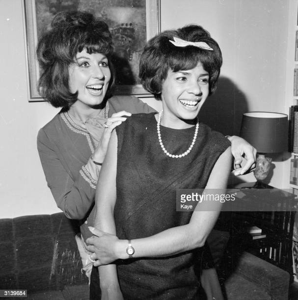 British pop singers Alma Cogan and Shirley Bassey