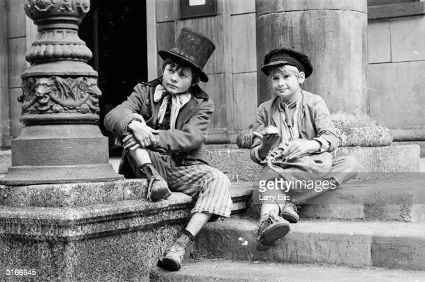 Child actors Jack Wild and Mark Lester, who play the Artful Dodger and Oliver Twist in Carol Reed's latest movie, the Lionel Bart musical 'Oliver!'