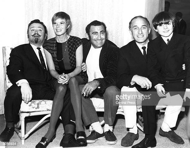 Members of the cast of the musical 'Oliver' based on the novel by Charles Dickens From left Sir Harry Secombe Shani Wallis the show's composer and...