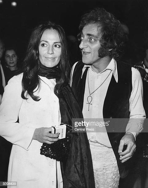British comedian Marty Feldman and his wife Loretta attend the premiere of 'Midnight Cowboy' at the London Pavilion Feldman wears an Egyptian ankh...