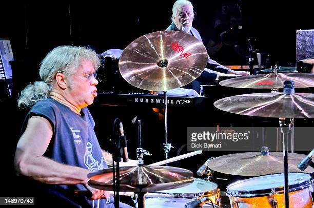 English drummer Ian Paice from Deep Purple performs live on stage with keyboard player Jon Lord behind at the Sunflower Jam in Porchester Hall London...
