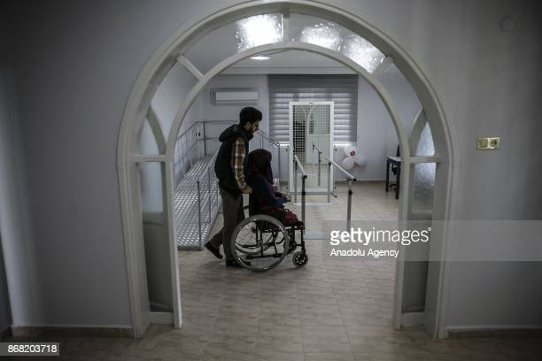 25yearold Syrian refugee Naghan Alwan fled from Syria's Idlib due to ongoing civilwar is seen on a wheelchair at a medical center after she got her...