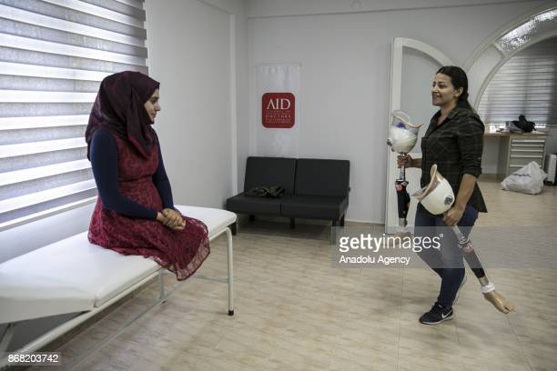 25yearold Syrian refugee Naghan Alwan fled from Syria's Idlib due to ongoing civilwar poses at a medical center after she got her prothesis legs in...