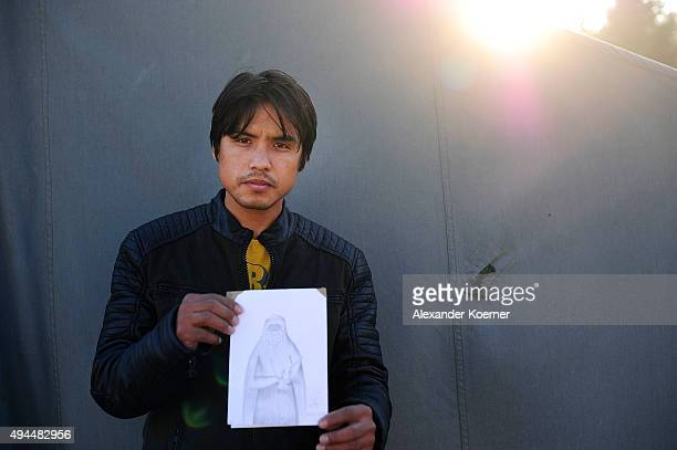 25yearold Yasin from the Qazni province in northern Afghanistan poses with a self created picture on October 27 2015 in Celle Germany The picture is...