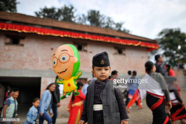 25yrs old Bewan Manandhar in a traditional attire arrive to participate in the festival with his family members during the tenth day of Dashain Durga...