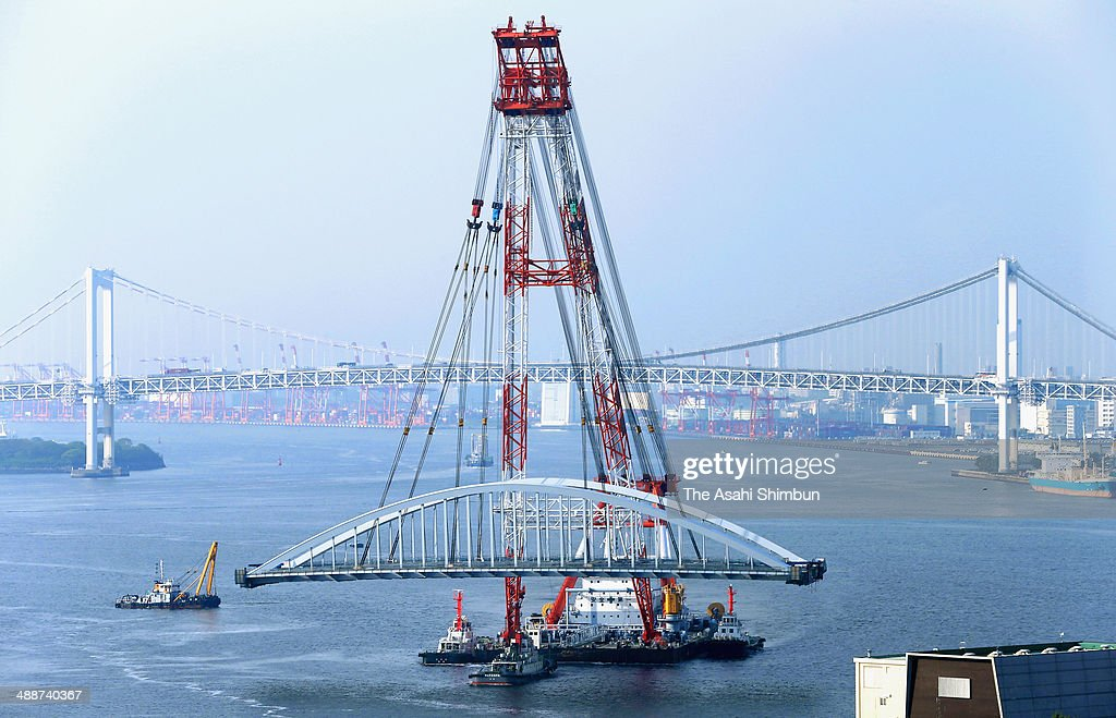 A 2,600-ton new bridge is carried by a huge crane on May 8, 2014 in Tokyo, Japan. The 120-meter bridge, assembled at Yokohama Port not to disturb the traffic of the Sumida River, will be part of Loop Line 2 which is an expected major traffic artery linking major venues at the 2020 Tokyo Summer Olympics.