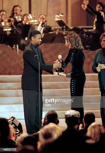 26th Annual NAACP IMAGE AWARDS Pictured Presenter Denzel Washington Whitney Houston Entertainer of the Year winner on stage during the 26th NAACP...