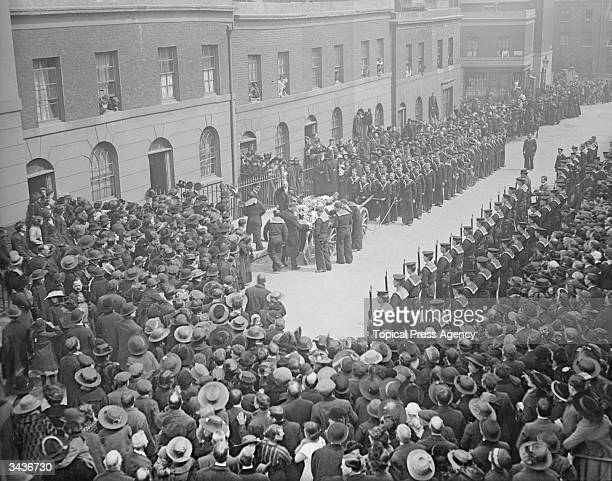Crowds and a naval guard of honour line the route at the funeral of Stoker F R Bailey at East Finchley north London His coffin is on a gun carriage...