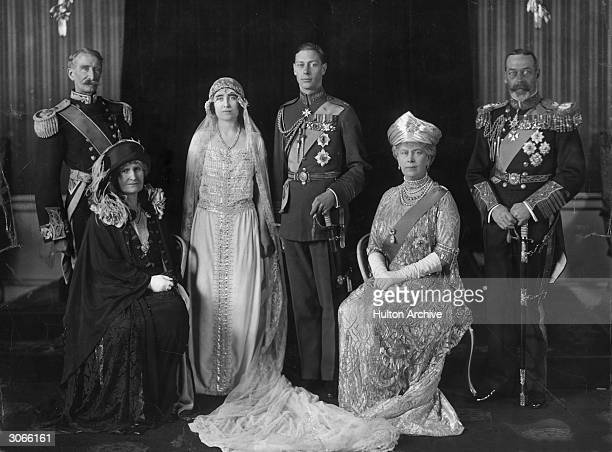 King George V of Great Britain and Queen Mary on the wedding day of their son George later King George VI to Elizabeth BowesLyon With them are the...