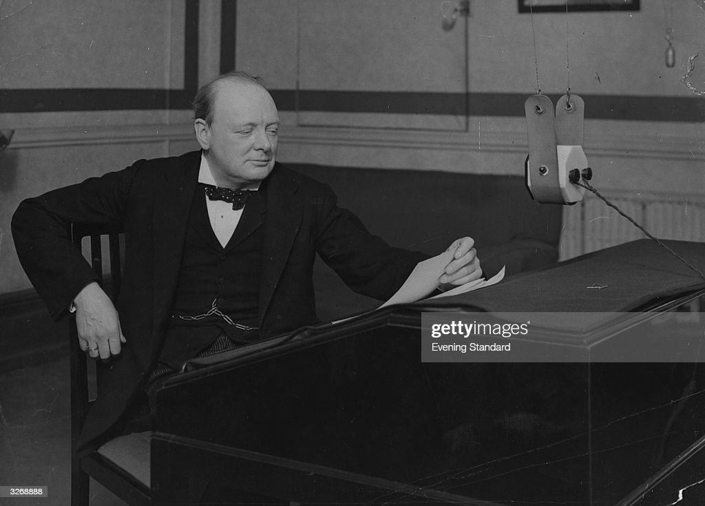 Winston Churchill, Conservative Chancellor of the Exchequer, broadcasting a summary of his budget from a BBC radio studio.