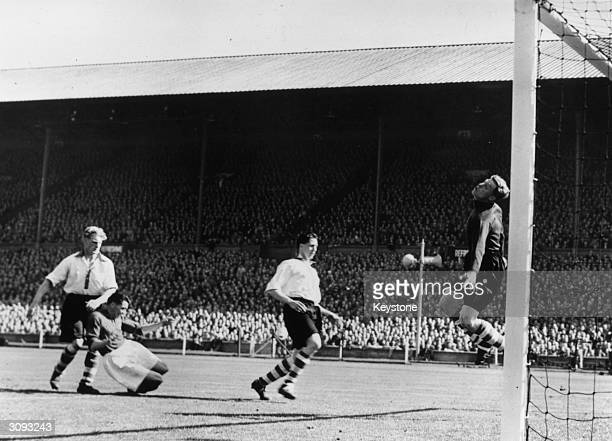 Charlton Athletic goalkeeper Sam Bartram makes a spectacular save during a Cup Final match between Charlton Athletic and Burnley at Wembley Stadium,...