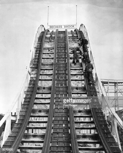 Workmen preparing a stretch of the Big Dipper called Becher's Brook for the start of the holiday season at Blackpool Pleasure Beach England
