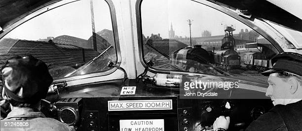 26th April 1962, The driver and fireman at the controls in the cab of The Flying Scotsman during its centenary journey from London to Edinburgh.
