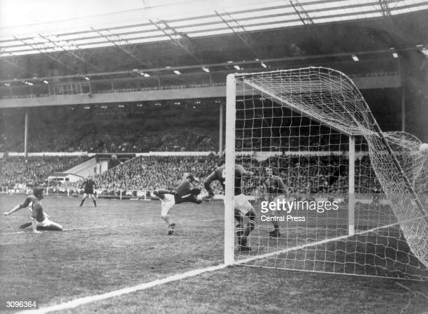 Leicester City Football Club goalkeeper Peter Shilton tries in vain to save the winning goal from Manchester City footballer Neil Young in the FA Cup...
