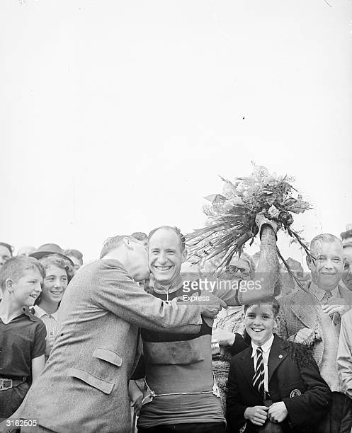 The BSA's Stan Jones celebrates his victory in the Daily Express Tour of Britain cycle race from Hastings to Southsea.