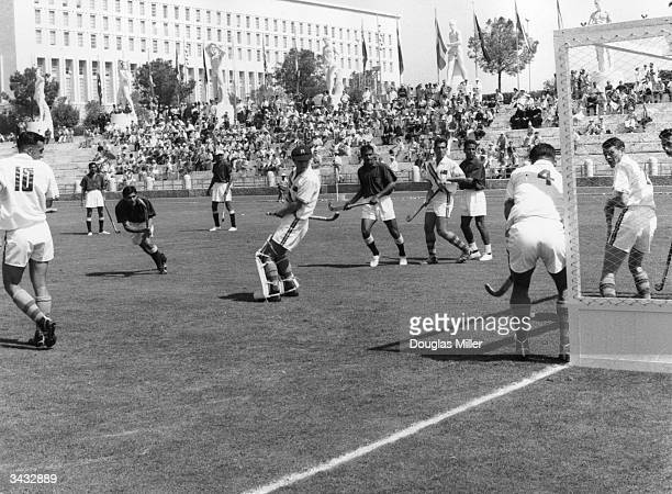 Australian goalkeeper, Lou Hailey, watches the progress of the ball from an attack by Pakistan, as Australia meet Pakistan in the men's hockey...