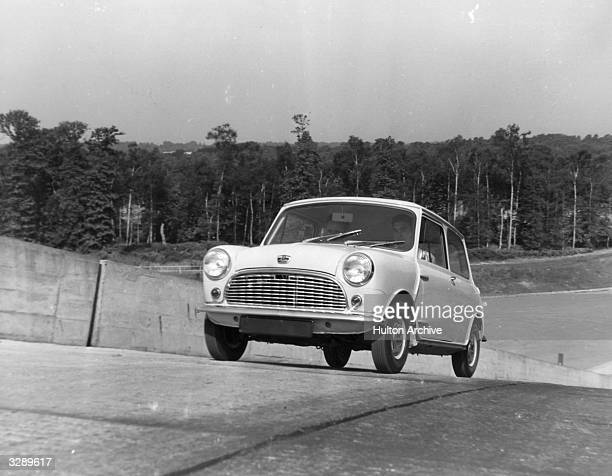 An Austin 7 motor car manufactured by the British Motor Corporation during a test drive on the 1 to 4 test gradient at Cobham Surrey It has...