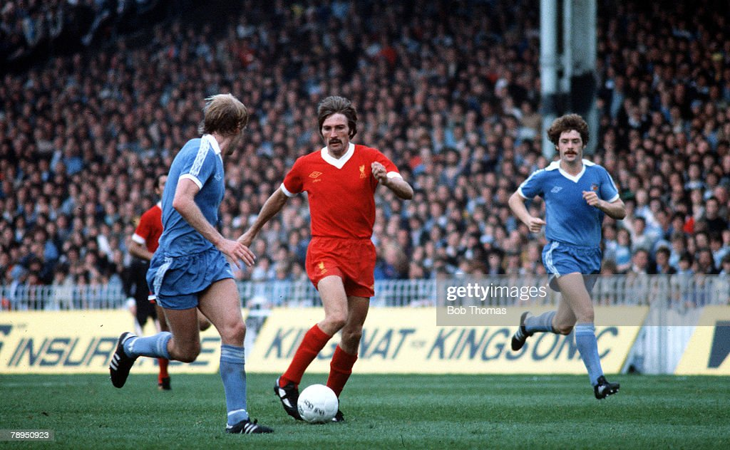 26th August 1978. Maine Road, Manchester. Manchester City v Liverpool. Liverpool's Steve Heighway takes on Manchester City's Futcher, as Clements chases. : News Photo