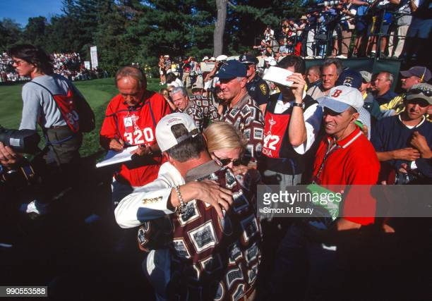 Ben Crenshaw captain of the USA team hugs his wife Julie after his team wins the Ryder Cup at The Country Club in Brookline Massachusetts on...