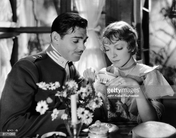 Angela Chiaromonte played by Helen Hayes reads the future in her tealeaves while Clark Gable as Giovanni Severi looks on in a scene from 'The White...