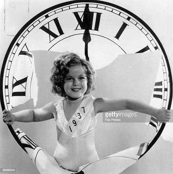American child star Shirley Temple celebrating the arrival of a new year