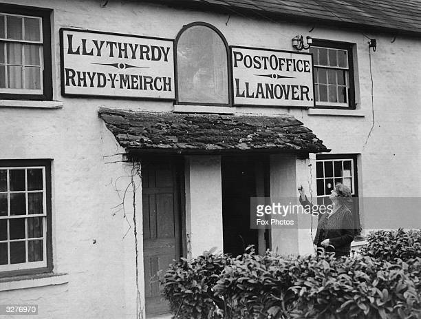 The village post office at Llanover Wales has a picture of the Mari Llwyd over the door showing the traditional Welsh Reel the painting is known to...