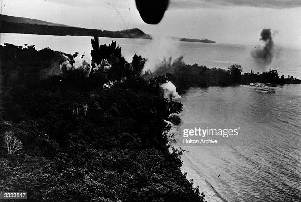 US Airforce planes score hits on Japanese positions at Cape Gloucester on the island of New Britain while the US army landed on the other side